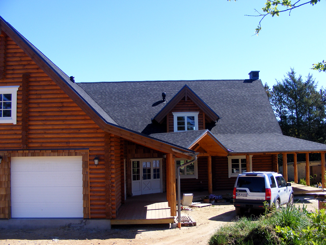 Log cabin house designs an excellent home design for Modern log home plans
